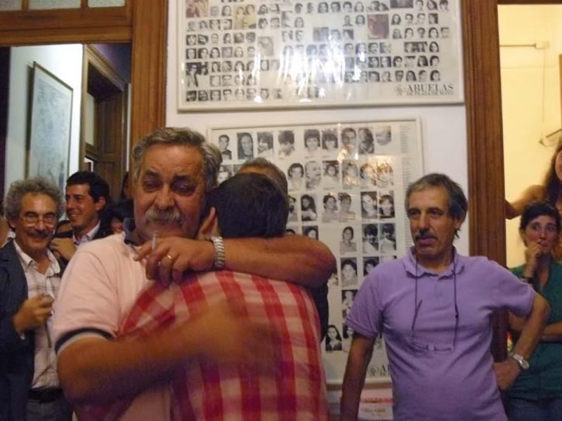 Abel Madariaga, secretary of Abuelas, locks in an embrace with his son Francisco after 33 years